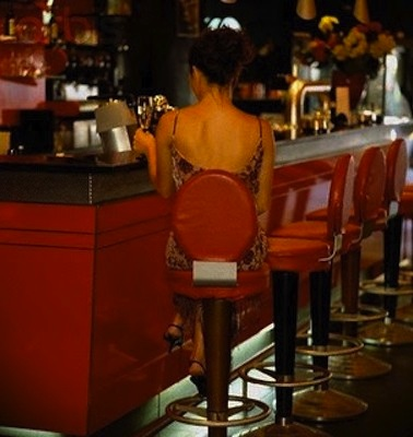 woman alone in bar